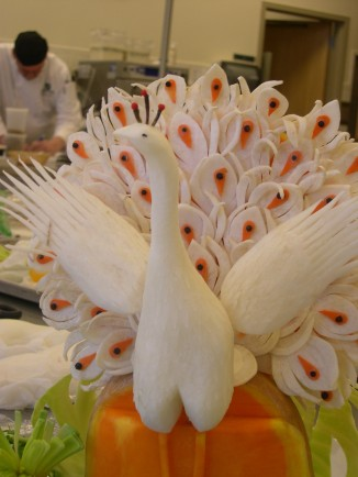 Peacock carved from Daikon Radish in Garde Manger