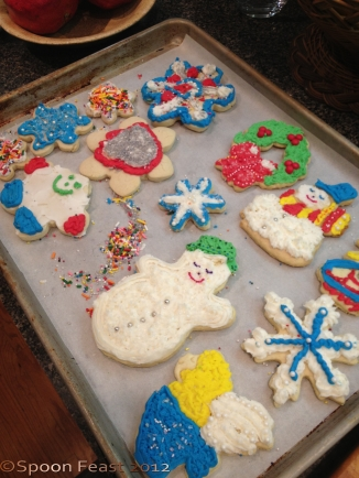 A fun tray of decorated cookies. Decorating on a tray catches all the tiny sugar bits that don't stick to the cookies.