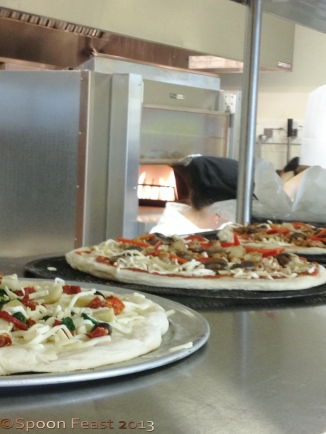 Pizza lining up for the oven