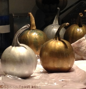 Painted Pumpkins Lined up to dry
