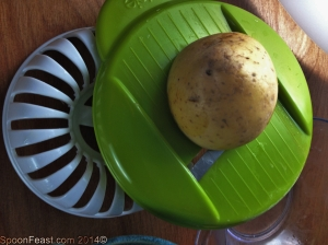 Slice the potatoes into the bowl